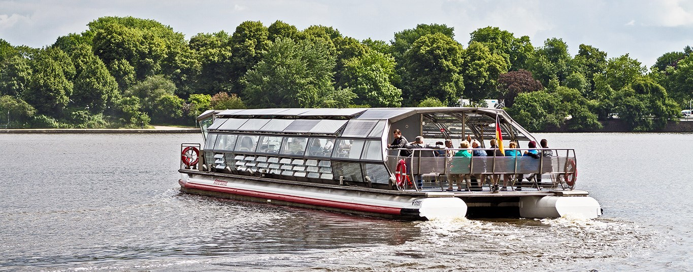 A solar-powered tourist boat on tour on a river in Hamburg, Germany
